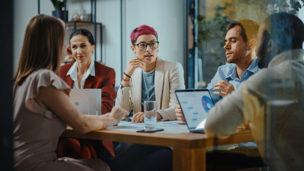 Diverse professionals in office meeting